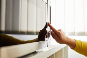 prevent static shock from touching microwave